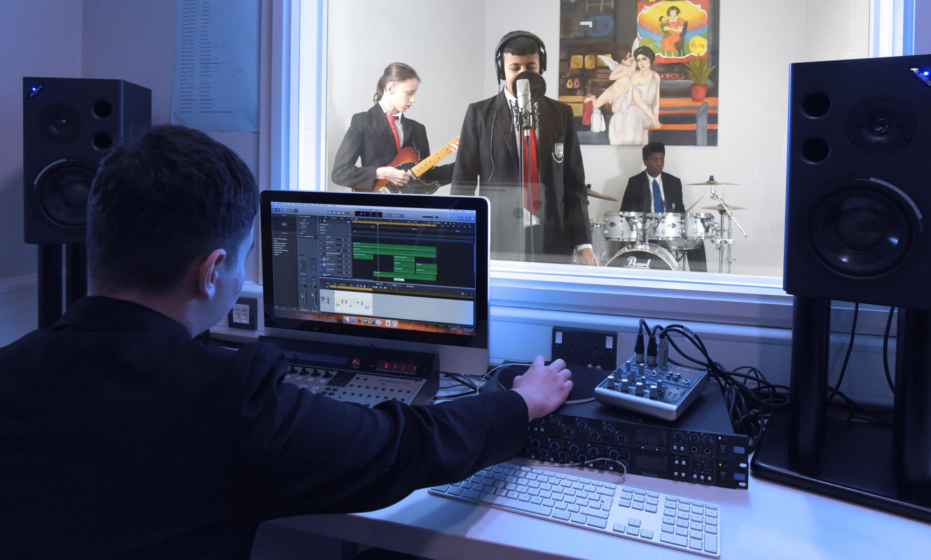 students performing and recording music in a studio