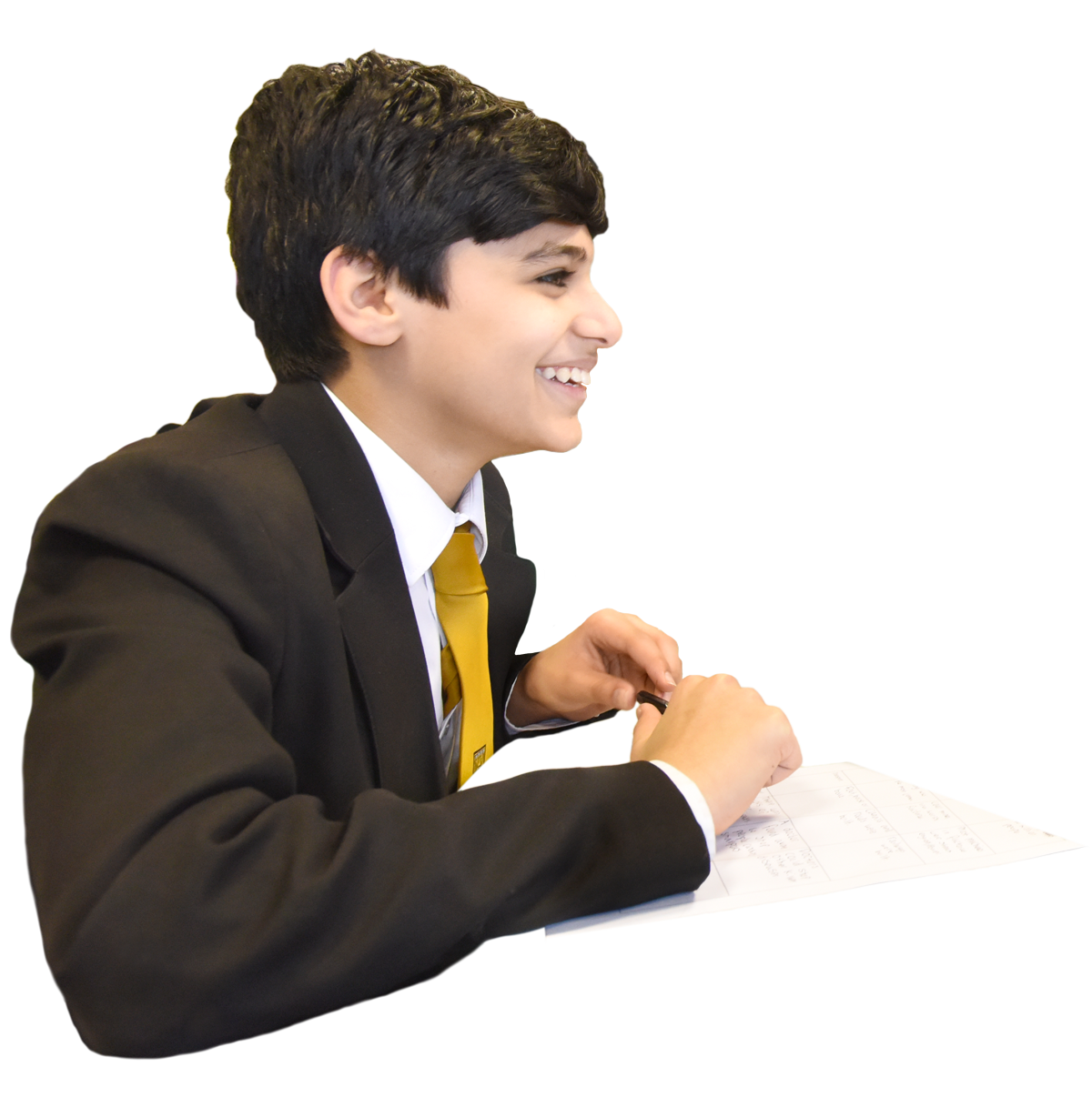 male student at desk taking notes