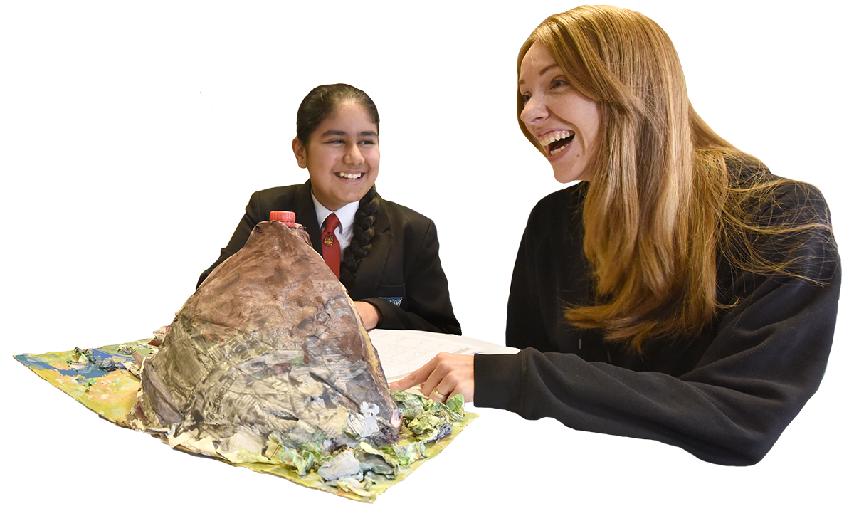 students sitting round a model volcano